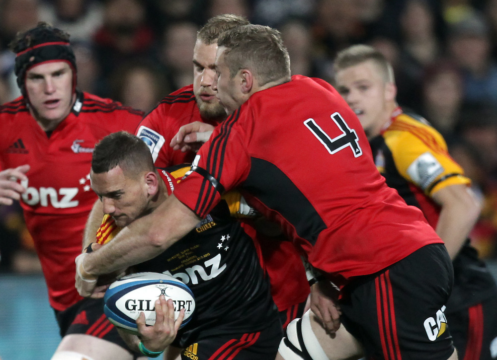 Chiefs' Aaron Cruden is tackled by Crusaders' Luke Romano in a Super Rugby semi final match, Waikato Stadium, Hamilton, New Zealand, Saturday, July 27, 2013.  Credit:SNPA / David Rowland