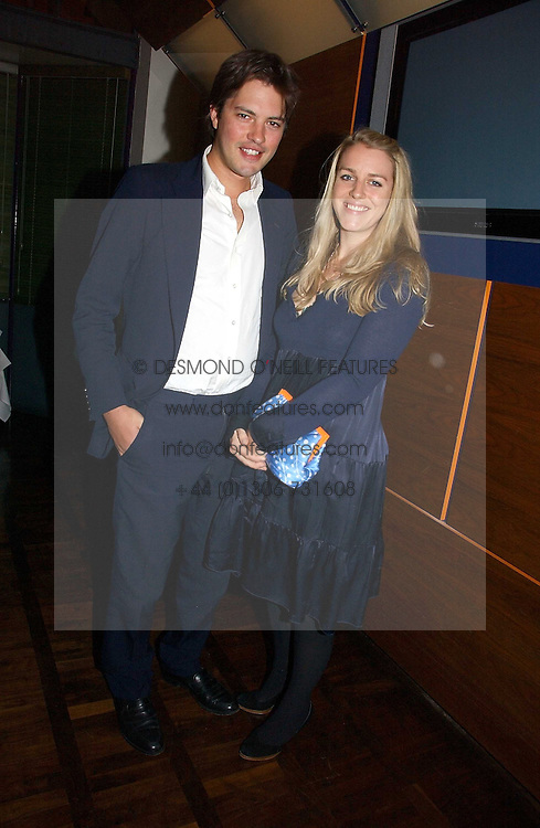 LAURA & HARRY LOPES at a party to celebrate the publication of 'The year of Eating Dangerously' by Tom Parker Bowles held at Kensington Place, 201 Kensington Church Street, London on 12th october 2006.<br />