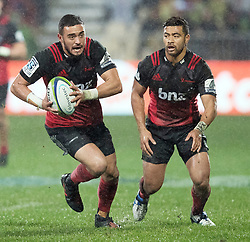 Crusaders Bryn Hall, left, makes a run against the Highlanders, as Richie Mo'unga looks on, in the Super Rugby quarter final match, AMI Stadium, Christchurch, New Zealand, July 22 2017.  Credit:SNPA / Adam Binns ** NO ARCHIVING**