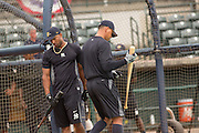 New York Yankees Alex Rodriguez walks past teammate Eduardo Nunez during batting practice before appearing in the first game since hip surgery with the minor league Charleston RiverDogs at Joseph P. Riley Jr. Stadium July 2, 2013 in Charleston, South Carolina.