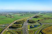 Nederland, Gelderland, Deil, 24-10-2013; knooppunt Deil, kruising A2 (vlnr, Utrecht - Den Bosch) en A15, richting Tiel. Betuweroute links en parallel aan A15.<br /> Deil junction, main motorway A15 Rotterdam Harbour - Germany crossing A2 to the South. <br /> luchtfoto (toeslag op standaard tarieven);<br /> aerial photo (additional fee required);<br /> copyright foto/photo Siebe Swart.