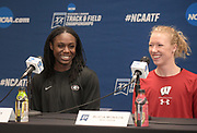 Lynna Irby of Georgia (left) and Alicia Monson of Wisconsin react during a press conference prior to the NCAA Indoor Track & Field Championships in Birmingham, Ala., Thursday, May 7, 2019.