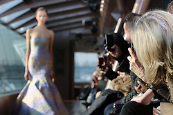 "Guests taking pictures during the Jessica Minh Anh's ""Catwalk On Water"" Winter Fashion Show 2017 held on Bateaux Mouches' Le Jean Bruel on The Seine River in Paris on Thursday January 26, 2017"