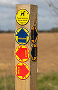 Close up of wooden post with byway and bridleway direction pointer signs, Sutton, Suffolk, England, Uk