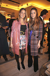 Left to right, sisters LYDIA FORTE and IRENE FORTE at a reception in aid of Children in Crisis held at the Roger Vivier store, 188 Sloane Street, London on 19th March 2009.