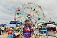Brooklyn, New York, USA. 10th August 2013. BOB YORBURG, AKA Professor Phineas FeelGood, the Magician, of Yorktown Heights, strikes a pose in front of the Wonder Wheel at Luna Park, during the 3rd Annual Coney Island History Day celebration. Yorburg restored Coney Island's famous Grandmothers Predictions fortune telling game after Grandma was seriously damaged during Hurricane Sandy, in October 2012.