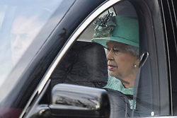 © Licensed to London News Pictures. 19/12/2019. London, UK.  QUEEN ELIZABETH II (L) is seen being driven down The Mall on their way back to Buckingham Palace after the State Opening of Parliament. Photo credit: Ben Cawthra/LNP