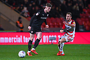 Liam Lindsay of Barnsley (6) and Herbie Kane of Doncaster Rovers (15) in action during the EFL Sky Bet League 1 match between Doncaster Rovers and Barnsley at the Keepmoat Stadium, Doncaster, England on 15 March 2019.