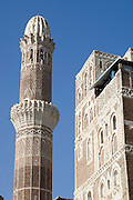 Minaret of Mosque next to Suq al-Milh, the Salt Market. Architecture within the walls of the Old City of San'a', (Sanaa).  The fortified city has many architectural gems and was declared a UNESCO World Heritage Site in 1984. San?a? , in the Yemeni highlands on a plateau at an altitude of 2200m  is surrounded by mountains.