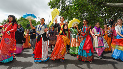 "© Licensed to London News Pictures. 16/06/2019. LONDON, UK.  Women dance at the head of the parade as devotees celebrate the annual Rathayatra festival (""cart festival""), in central London.  Hare Krishna followers tow three huge decorated carts from Hyde Park corner to Trafalgar Square, singing and dancing all the way..  Photo credit: Stephen Chung/LNP"