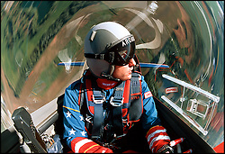 Airshow performer Marcus Schrenker performs a torque roll in his Extra 300L.
