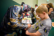 Joshua Butterworth, 8, of Fort Pierce, has his shirt signed by Lince Dorado, one of the more popular wrestlers among younger fans, during Championship Wrestling Entertainment's Live Pro Wrestling on Friday, May 15, 2015, at the Port St. Lucie Civic Center. (XAVIER MASCAREÑAS/TREASURE COAST NEWSPAPERS)