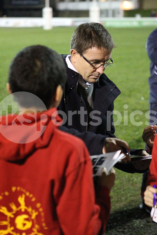 Mike Friday signs an autograph for young fans after the Green King IPA Championship match between London Scottish &amp; Jersey at Richmond, Greater London on Friday 14th November 2014<br /> <br /> Photo: Ken Sparks | UK Sports Pics Ltd<br /> London Scottish v Jersey, Green King IPA Championship,14th November 2014<br /> <br /> &copy; UK Sports Pics Ltd. FA Accredited. Football League Licence No:  FL14/15/P5700.Football Conference Licence No: PCONF 051/14 Tel +44(0)7968 045353. email ken@uksportspics.co.uk, 7 Leslie Park Road, East Croydon, Surrey CR0 6TN. Credit UK Sports Pics Ltd