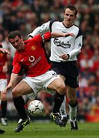 Photo. Javier Garcia<br />05/04/2003 Man Utd v Liverpool, FA Barclaycard Premiership, Old Trafford<br />Returning Roy Keane is pressured by Dietmar Hamann