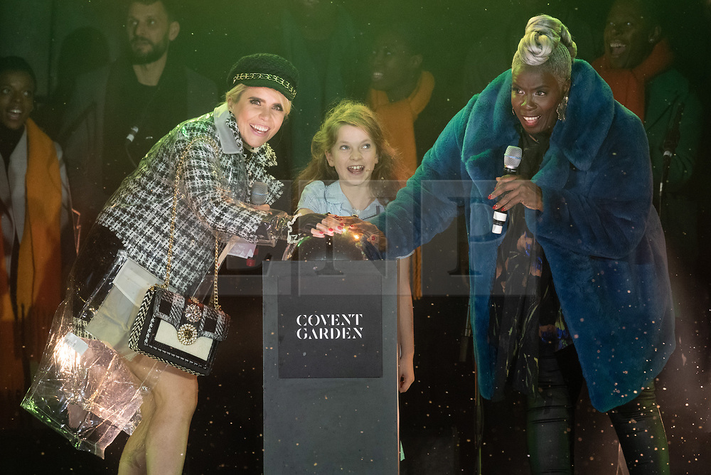 © Licensed to London News Pictures. 13/11/2018. London, UK. Singer PALOMA FAITH, SARA MUNDAY from Matilda The Musical and Choral Conductor KAREN GIBSON turn on the lights of Covent Garden Market Christmas lights. Photo credit: Ray Tang/LNP