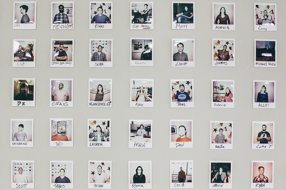 A wall full of employee instant photos in the break room at VOX Media in Washington, D.C.