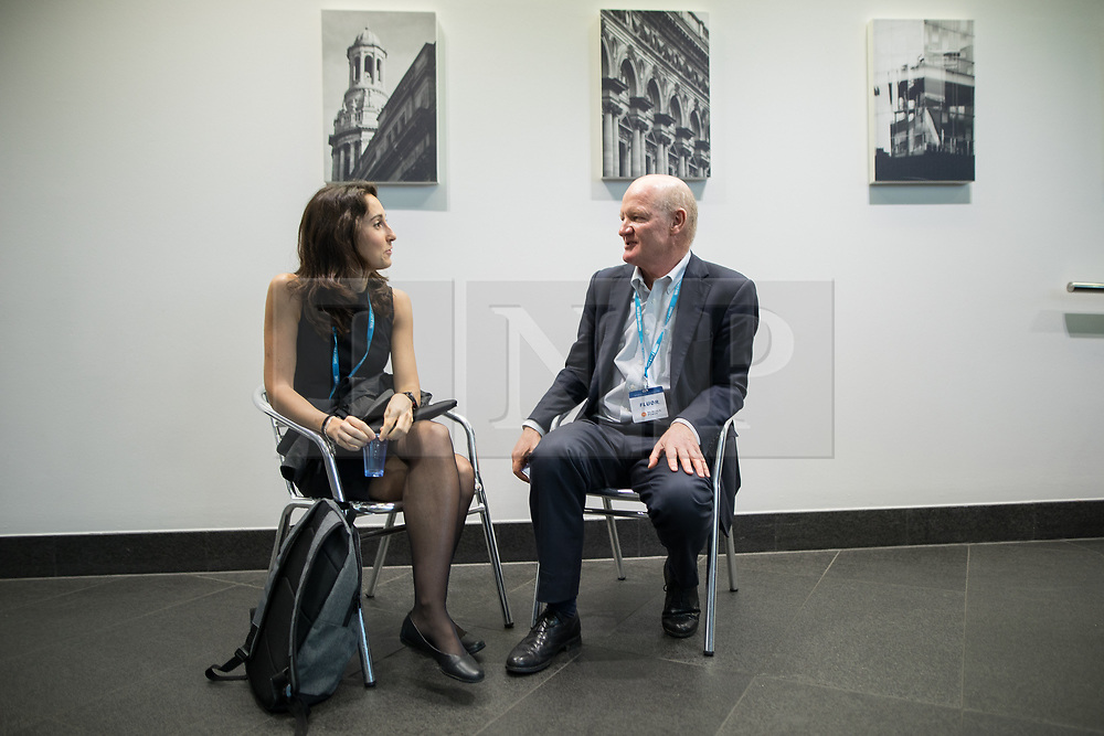 © Licensed to London News Pictures . 02/10/2017. Manchester, UK. DAVID WILLETTS (r) talking with a delegate . The second day of the Conservative Party Conference at the Manchester Central Convention Centre . Photo credit: Joel Goodman/LNP