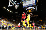 ANN ARBOR, MI - FEBRUARY 5: Shannon Scott #3 of the Ohio State Buckeyes drives for a lay up past Caris LeVert #23 of the Michigan Wolverines during the game at Crisler Center in Ann Arbor, Michigan on February 5. Michigan won 76-74. (Photo by Joe Robbins)