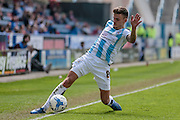 Jamie Paterson (Huddersfield Town) just keeps the ball in play during the Sky Bet Championship match between Huddersfield Town and Brentford at the John Smiths Stadium, Huddersfield, England on 7 May 2016. Photo by Mark P Doherty.