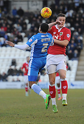 Bristol City's Matt Smith challenges for the header with Colchester United's Alex Wynter - Photo mandatory by-line: Dougie Allward/JMP - Mobile: 07966 386802 - 21/02/2015 - SPORT - Football - Colchester - Colchester Community Stadium - Colchester United v Bristol City - Sky Bet League One