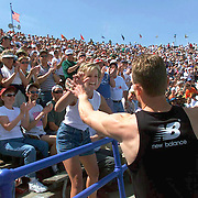 des moines, april 2000 - Joey Woody greets his wife Heather after winning the Drake Relays 400 meter hurdles in April.