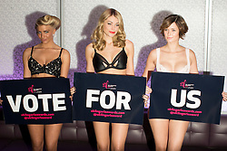 © licensed to London News Pictures. London, UK 06/11/2013. Amy Levick, Georgia Horsley and Rose Killin posing at a photo call to launch The UK Lingerie Awards at Aura nightclub in Mayfair, London. Photo credit: Tolga Akmen/LNP