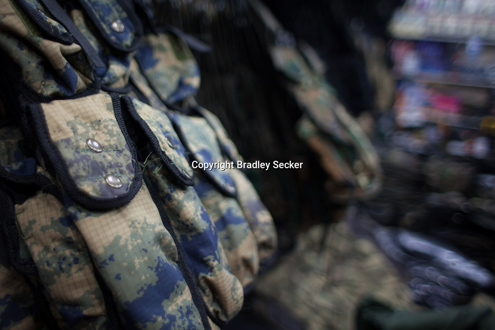 ANTAKYA, TURKEY. JANUARY 23. Ammunition belts are on sale in varying designs and prints, in a military supply store in Antakya, close to Syria's border with Turkey. Bradley Secker for the Washington Post