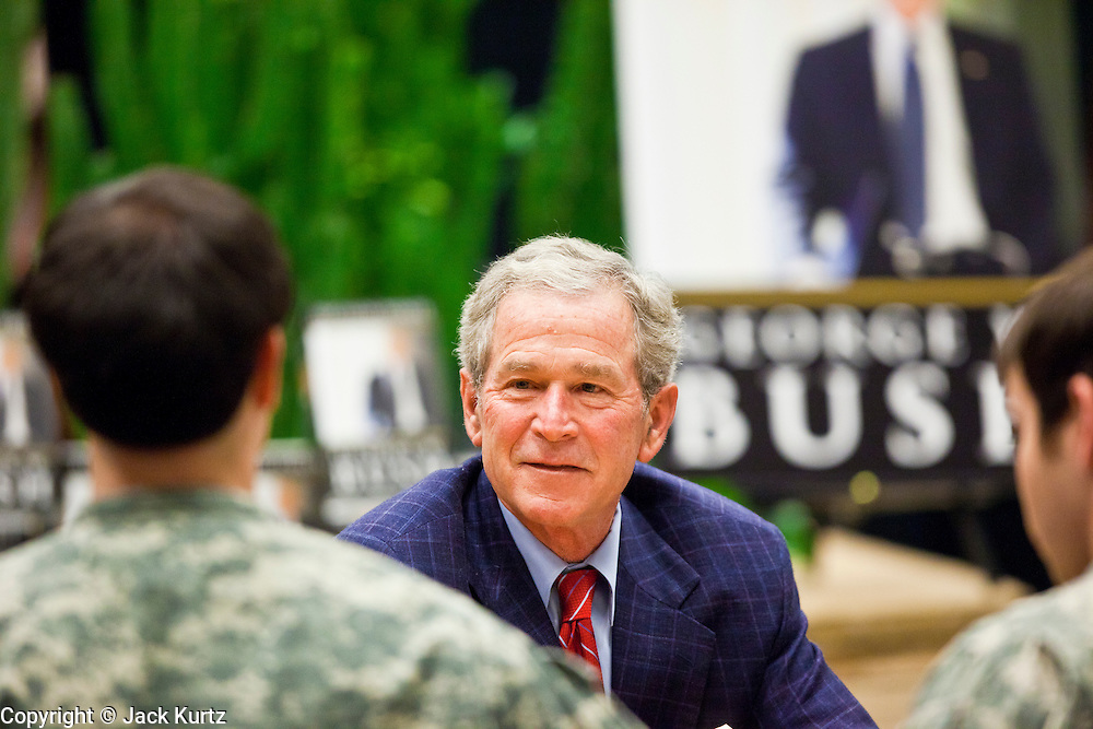 "09 DECEMBER 2010 - PHOENIX, AZ: Former President GEORGE W. BUSH greets American soldiers and signs copies of his book, ""Decision Points"" at the Barnes & Noble Bookstore in Phoenix, AZ, Thursday, Dec. 9. More than 2,000 people lined up starting at 5AM to get copies of the former President's book, ""Decision Points."" A handful of protesters demonstrated against President Bush near the bookstore, calling him a ""war criminal.""  PHOTO BY JACK KURTZ"