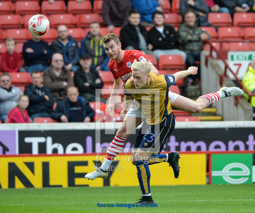 Sam Winnall of Barnsley and Hordur Magnusson of Bristol City during the Sky Bet Championship match at Oakwell, Barnsley<br /> Picture by Richard Land/Focus Images Ltd +44 7713 507003<br /> 29/10/2016