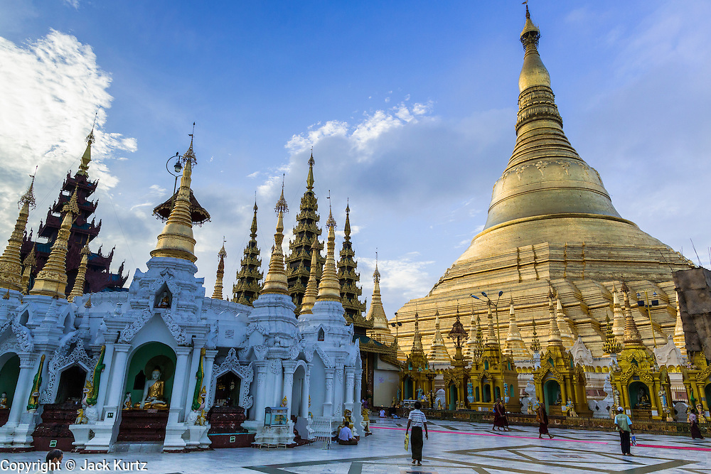 15 JUNE 2013 - YANGON, MYANMAR:  Shwedagon Pagoda is officially known as Shwedagon Zedi Daw and is also called the Great Dagon Pagoda or the Golden Pagoda. It is a 99 metres (325ft) tall pagoda and stupa located in Yangon, Burma. The pagoda lies to the west of on Singuttara Hill, and dominates the skyline of the city. It is the most sacred Buddhist pagoda in Myanmar and contains relics of the past four Buddhas enshrined: the staff of Kakusandha, the water filter of Koṇāgamana, a piece of the robe of Kassapa and eight strands of hair fromGautama, the historical Buddha. The pagoda was built between the 6th and 10th centuries by the Mon people, who used to dominate the area around what is now Yangon (Rangoon). The pagoda has been renovated numerous times through the centuries. Millions of Burmese and tens of thousands of tourists visit the pagoda every year, which is the most visited site in Yangon.  PHOTO BY JACK KURTZ