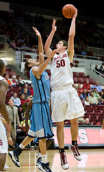 November 6, 2009; Stanford, CA, USA;  Stanford Cardinal forward Jack Trotter (50) shoots over Sonoma State Seawolves guard/forward Jason Walter  (21) during the first half of an exhibition game at Maples Pavilion.