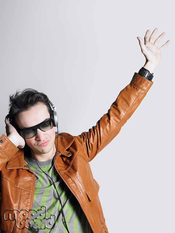 Man wearing headphones and sunglasses head and shoulders