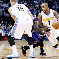 16 November 2016: Denver Nuggets guard Jameer Nelson (1) drives past Phoenix Suns guard Eric Bledsoe (2) on a screen set by Denver Nuggets forward Nikola Jokic (15) during the Denver Nuggets 120-104 victory over the Phoenix Suns, at the Pepsi Center, Denver, Colorado, USA.