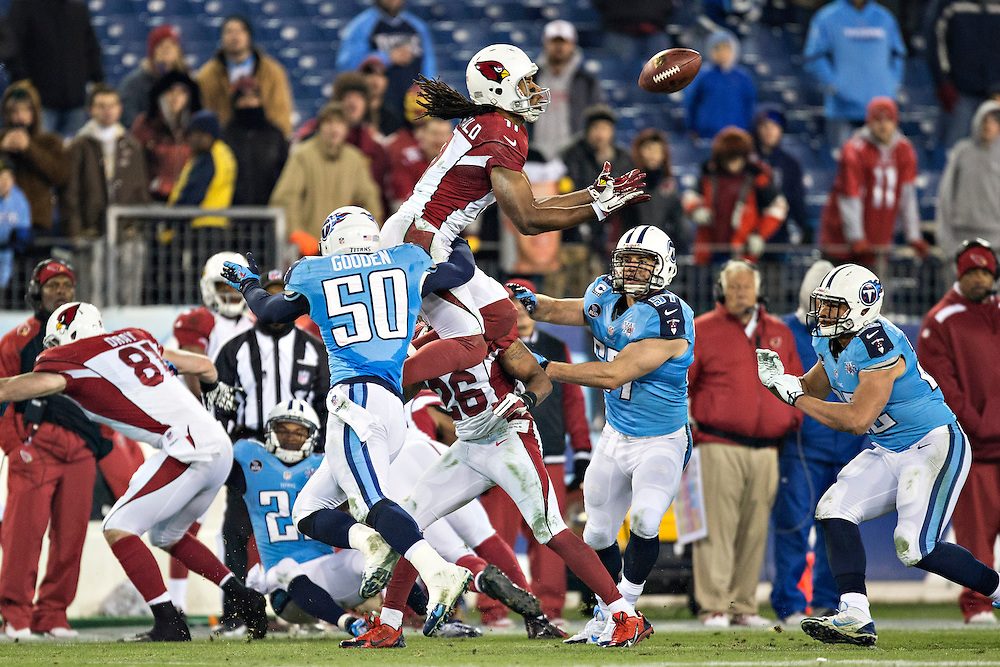 NASHVILLE, TN - DECEMBER 15:  Larry Fitzgerald #11 of the Arizona Cardinals jumps to get a on side kickoff but is hit and fumbles the ball against the Tennessee Titans at LP Field on December 15, 2013 in Nashville, Tennessee.  The Cardinals defeated the Titans 37-34.  (Photo by Wesley Hitt/Getty Images) *** Local Caption *** Larry Fitzgerald
