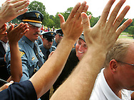 Phil Mickelson (R) shakes hands with fans after winning the 2005 PGA Championship at Baltusrol Golf Club in Springfield, New Jersey, Monday 15 August 2005. Mickelson won his second major title by one shot on Monday after the tournement was weather delayed on Sunday.