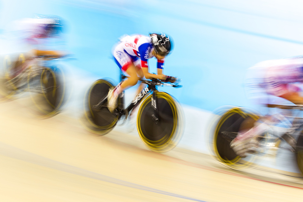 The Chilean team competes in the women's team pursuit qualification on the fist day of track cycling at the 2015 Pan American Games in Toronto, Canada, July 16,  2015.  AFP PHOTO/GEOFF ROBINS