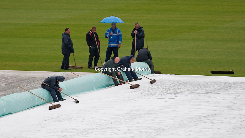 Heads go down amonst the groundstaff as more rain puts the start back again during the final day of the first npower Test Match between England and Sri Lanka at the SWALEC Stadium, Cardiff.  Photo: Graham Morris (Tel: +44(0)20 8969 4192 Email: sales@cricketpix.com) 30/05/11