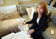 Wendy Laquay of Langhorne, Pennsylvania goes through some of the paperwork about her water bill, from Bucks County Water and Sewer Authority, which was over $500 after the company installed a new water meter at her home Monday October 19, 2015 at Warminster Community Park in Warminster, Pennsylvania.  (Photo by William Thomas Cain)