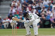 Ben Coad of Yorkshire takes evasive action from a short ball deliverd by Oliver Hannon-Dalby of Warwickshire during the Specsavers County Champ Div 1 match between Yorkshire County Cricket Club and Warwickshire County Cricket Club at York Cricket Club, York, United Kingdom on 18 June 2019.