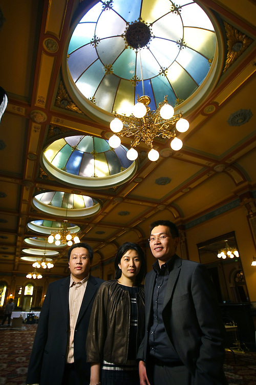 In the Windsor Hotel Ballroom, Left to right, Syah Poetra and his sister Yuliawaty Halim, and brother Adi Halim. Adi Halim is one of the directors of the Halim Group, the company that owns and wants to redevelop the Windsor Hotel 25/03/2010 Pic By Craig Sillitoe SPECIAL 000  Pic By Craig Sillitoe CSZ / The Sunday Age melbourne photographers, commercial photographers, industrial photographers, corporate photographer, architectural photographers, This photograph can be used for non commercial uses with attribution. Credit: Craig Sillitoe Photography / http://www.csillitoe.com<br />