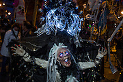 New York, NY - October 31, 2015. Masked figure and marionette at the Greenwich Village Halloween Parade.