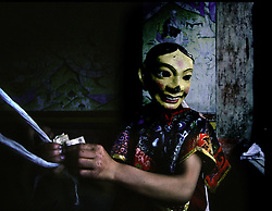 A young Ladakhi Buddhist who is studying to become a monk wears a mask during the annual festival celebrating the birth anniversary of Guru Padmasambhava, the founder of Lamaism (an off-shoot of Buddhism) in the eighth century. The two-day festival is marked by ritual dancing  in Hemis Gumpa, 28 miles southeast of Leh in the northern Indian state of Jammu and Kashmir June 28 and 29, 2004. The Hemis Gumpa is the oldest and largest monastery in Ladakh.