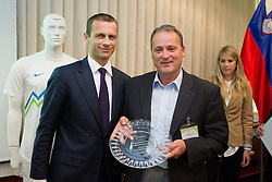 Aleksander Ceferin, president of NZS with honored worker in Slovenian football during General Assembly of  Football Association of Slovenia - NZS, on April 19, 2012 in Hotel Kokra, Brdo pri Kranju, Slovenia.  (Photo by Vid Ponikvar / Sportida.com)
