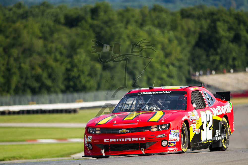 """Lexington, OH - AUG 15, 2013: The NASCAR Nationwide Series teams take to the track during practice for the Nationwide Children's Hosp. 200 at the Mid-Ohio Sports Car Course in Lexington, OH, Larson, McDonalds, Eveready, 32, Chevy, """"Scott Jr."""","""