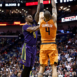 Feb 6, 2017; New Orleans, LA, USA; New Orleans Pelicans forward Terrence Jones (9) shoots over Phoenix Suns center Tyson Chandler (4) during the second quarter of a game at the Smoothie King Center. Mandatory Credit: Derick E. Hingle-USA TODAY Sports