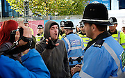 Conservative Party Conference, ICC, Birmingham, Great Britain <br /> Day 1<br /> 7th October 2012 <br /> <br /> <br /> Badger protestor talks to Police liaison officer <br /> <br /> Photograph by Elliott Franks<br /> <br /> Tel 07802 537 220 <br /> elliott@elliottfranks.com<br /> <br /> ©2012 Elliott Franks<br /> Agency space rates apply