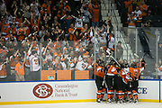RIT players celebrate a goal late in the third period against Robert Morris University during the Atlantic Hockey final at the Blue Cross Arena in Rochester on Saturday, March 19, 2016.