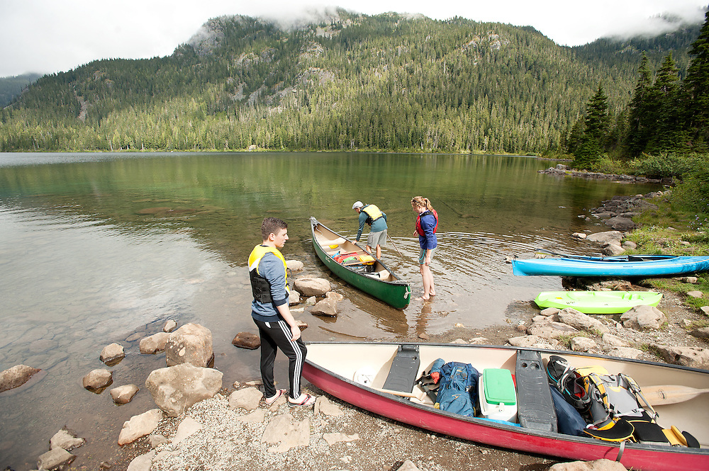 A group of canoe campers push off for a trip across Callaghan Lake Saturday afternoon.  Saturday, Sept. 3, 2016.<br /> <br /> Photo:  David Buzzard