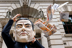 © Licensed to London News Pictures. 12/08/2015. London, UK. A protester wearing George Osborne mask and holding fake money protest against the government's RBS shares sell-off outside HM Treasury in London on Wednesday, August 12, 2015 as 'Move Your Money' campaign group delivers  a petition signed by 118,000 to HM Treasury. Photo credit: Tolga Akmen/LNP