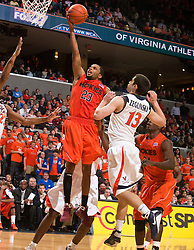 Virginia Tech guard Malcolm Delaney (23) shoots against UVA.  The Virginia Cavaliers defeated the Virginia Tech Hokies 75-61 at the John Paul Jones Arena on the Grounds of the University of Virginia in Charlottesville, VA on February 18, 2009.